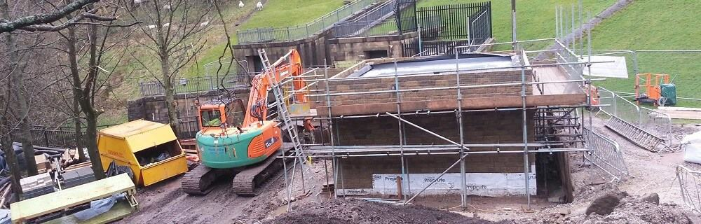 Turbine house emerges out of the ground at Dovestone Reservoir