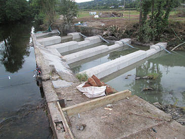 Partially completed pool and weir fish pass