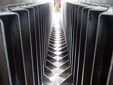 Steel fabricated baffles in concrete channel Alaskan 'A' fish pass.